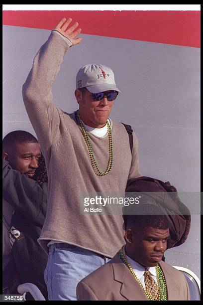 Quarterback Brett Favre of the Green Bay Packers waves as he gets off a plane at the New Orleans International Airport in preparation for Super Bowl...