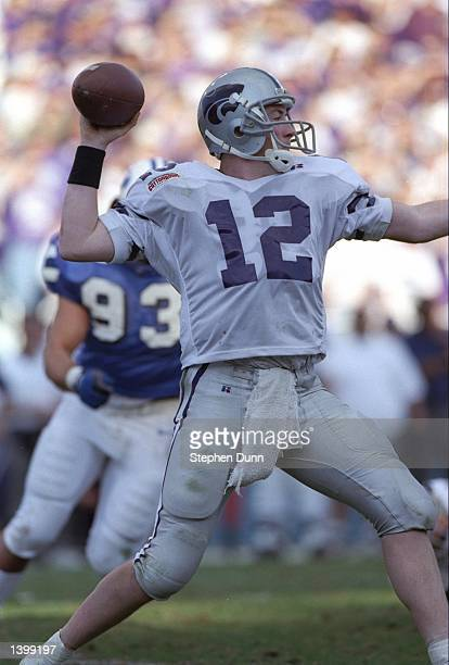Quarterback Brian Kavanaugh of the Kansas State Wildcats passes the ball during the Cotton Bowl against the Brigham Young Cougars at the Cotton Bowl...