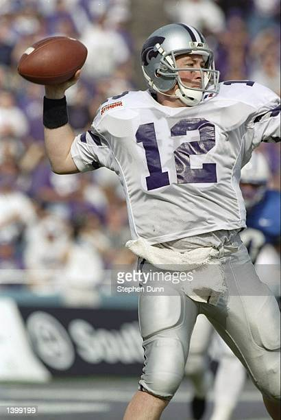 Quarterback Brian Kavanaugh of the Kansas State Wildcats drops back to pass during the Cotton Bowl against the Brigham Young Cougars at the Cotton...