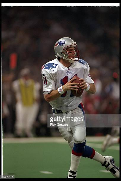 Quarterback Drew Bledsoe of the New England Patriots fades back to pass the ball during Super Bowl XXXI against the Green Bay Packers at the...
