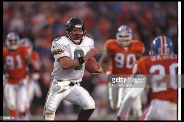 Quarterback Mark Brunell of the Jacksonville Jaguars moves the ball during a playoff game against the Denver Broncos at Mile High Stadium in Denver...