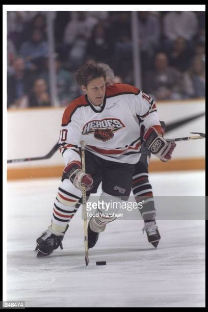 Ron Duguay of California moves the puck during the Heroes of Hockey game against the NHL at the San Jose Arena in San Jose, California. The NHL won...