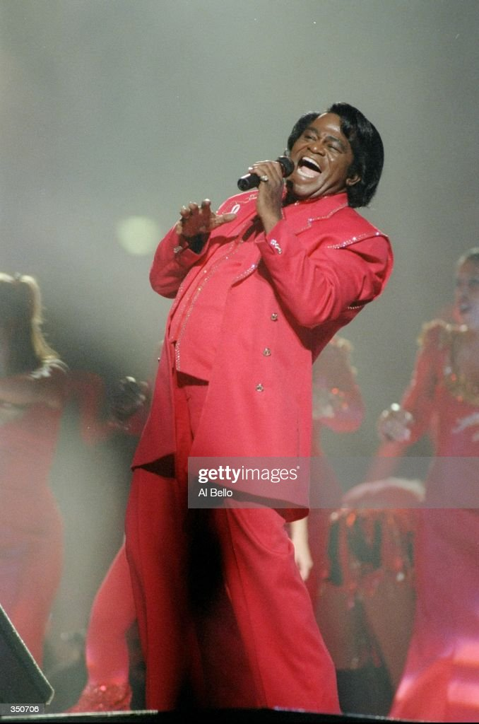 Singer James Brown performs during the half-time show for Super Bowl XXXI between the New England Patriots and the Green Bay Packers at the Superdome in New Orleans, Louisiana. The Packers won the game, 35-21.