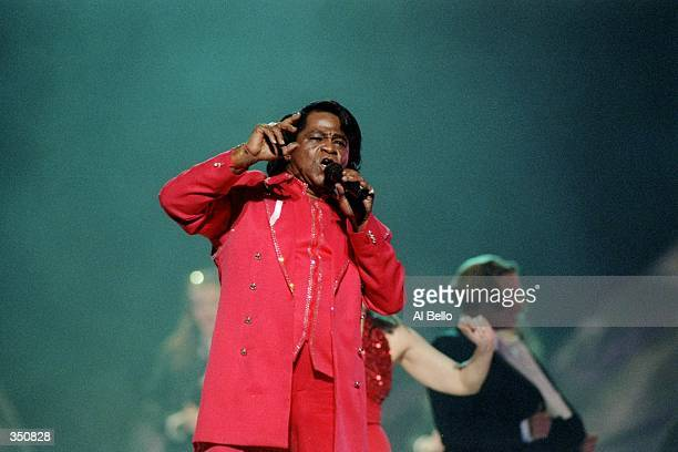 Singer James Brown performs during the half-time show for Super Bowl XXXI between the New England Patriots and the Green Bay Packers at the Superdome...
