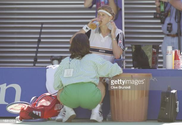 Steffi Graf of Germany receives treatment from the courtside doctor in her match against Amanda Coetzer of South Africa During the fourth round of...
