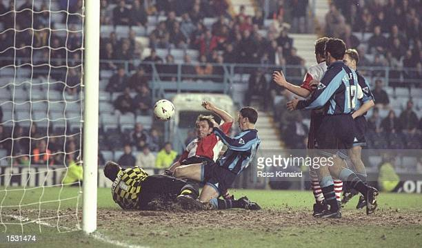 Steve Thompson scores for Woking and earns his team a valuble replay during the FA cup fourth round tie betweem Coventry city and Woking at the City...