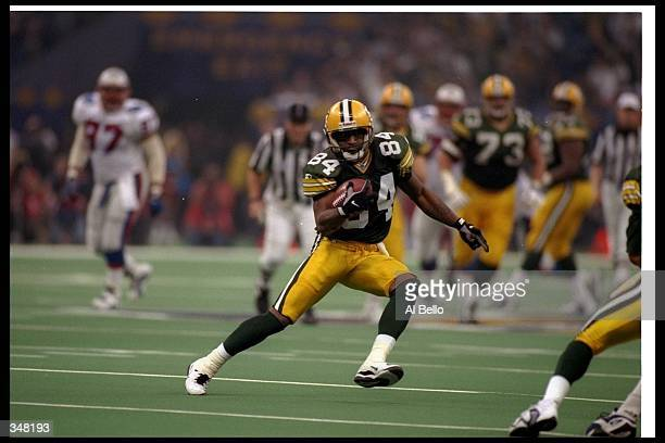 Wide receiver Andre Rison of the Green Bay Packers runs with the ball during Super Bowl XXXI against the New England Patriots at the Superdome in New...