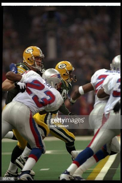Wide receiver Desmond Howard of the Green Bay Packers moves the ball during Super Bowl XXXI against the New England Patriots at the Superdome in New...