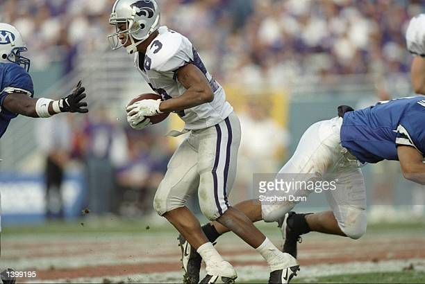 Wide receiver Kevin Lockett of the Kansas State Wildcats runs down the field during the Cotton Bowl against the Brigham Young Cougars at the Cotton...