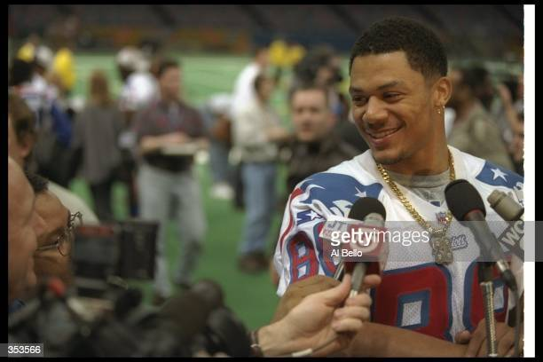 Wide receiver Terry Glenn of the New England Patriots gets interviewed during Media Day for Super Bowl XXXI against the Green Bay Packers at the...