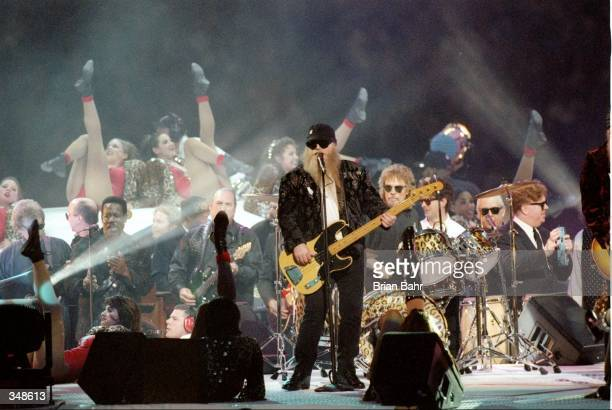 Top performs during the half-time show for Super Bowl XXXI between the New England Patriots and the Green Bay Packers at the Superdome in New...