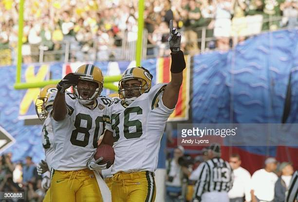 Antonio Freeman of the Green Bay Packers celebrates with teammate Derrick Mayes after scoring a touchdown against the Denver Broncos during Super...