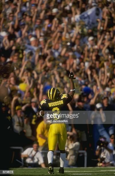 Charles Woodson of Michigan celebrates during a game against Washington State at Rose Bowl in Pasadena California Michigan defeated Washington State...