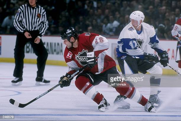 Eric Lindros of team North America in action against team World during the 1998 NHL AllStar Game at General Motors Palace in Vancouver Canada North...