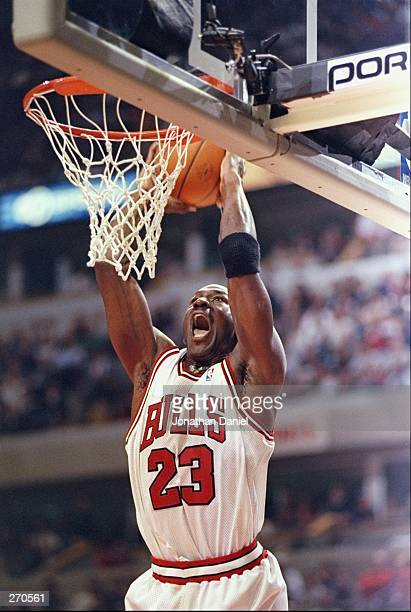 Guard Michael Jordan of the Chicago Bulls sinks the ball during a game against the Seattle SuperSonics at the United Center in Chicago Illinois The...