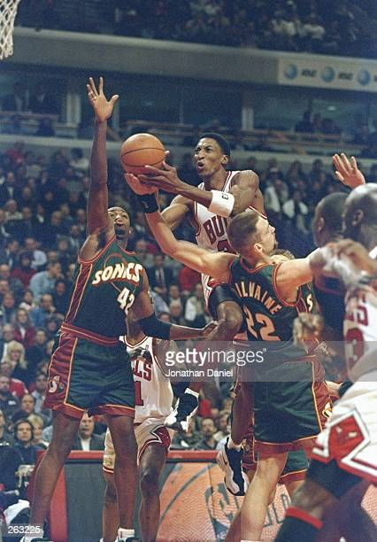 Guard Scottie Pippen of the Chicago Bulls goes up for two during a game against the Seattle Supersonics at the United Center in Chicago, Illinois....