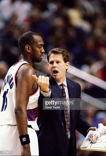 Head coach Danny Ainge and forward Danny Manning of the Phoenix Suns confer during a game against the Orlando Magic at the America West Arena in...
