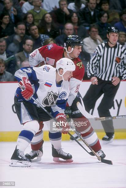 Igor Larionov of team World in action against Mike Modano team North America during the 1998 NHL AllStar Game at General Motors Palace in Vancouver...