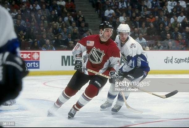 John LeClair of the North America Team in action against Peter Forsberg of the World Team during the NHL AllStar Game at the General Motors Place in...
