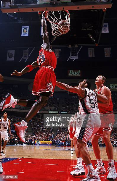 Michael Jordan of the Chicago Bulls dunks the ball during the game against the New Jersey Nets at the Continental Arena in East Rutherford New Jersey...