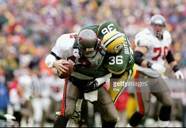 Quarterback Trent Dilfer of the Tampa Bay Buccaneers is sacked by cornerback Leroy Butler of the Green Bay Packers during a playoff game at the...