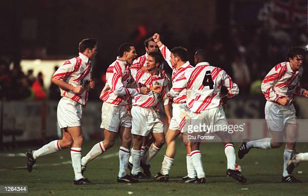 Stevenage Borough players celebrate Giuliano Grazioli's goal during the FA Cup fourth round tie against Newcastle United at Broadhall Way in...