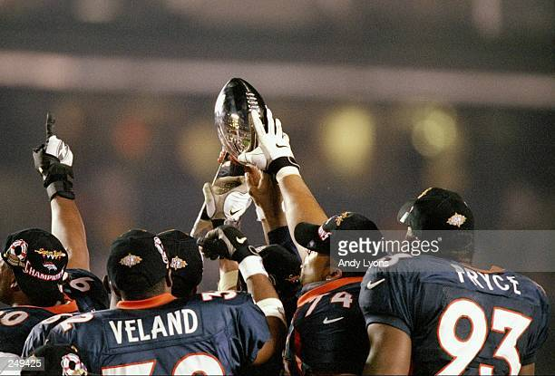 The Denver Broncos hold up the Lombardi Trophy after defeating the Green Bay Packers in Super Bowl XXXII at Qualcomm Stadium in San Diego California...