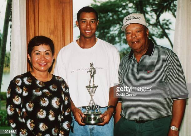 Tiger Woods with his parents Kultida and Earl Woods at the Johnnie Walker Classic at Blue Canyon Golf Club Thailand Mandatory Credit David...