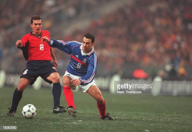 Youri Djorkaeff of France challenges Guilermo Martinez of Spain during the International Friendly at the Stade De France in Paris France France won...