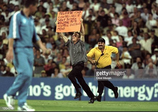 Madman invades the pitch during the Carlton & United 1 Day Series between Australia and England in Sydney, Australia. \ Mandatory Credit: Clive Mason...