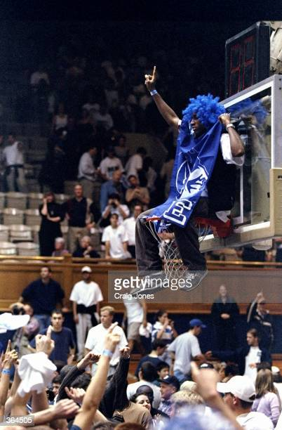 Roudy fan of the Duke Blue Devils jumps and sits on the basket after the game against of the North Carolina Tar Heels at the Cameron Indoor Stadium...