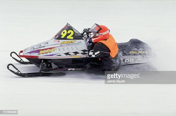 A snowmobiler in action during the World Championship Snowmobile Derby in Eagle River Wisconsin Mandatory Credit Jamie Squire /Allsport
