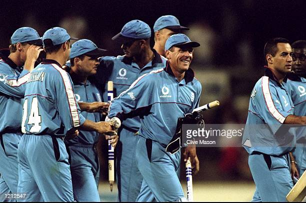 Alec Stewart the English captain celebrates with the rest of his team after beating Sri Lanka in the Carlton United One Day Series in Perth Australia...