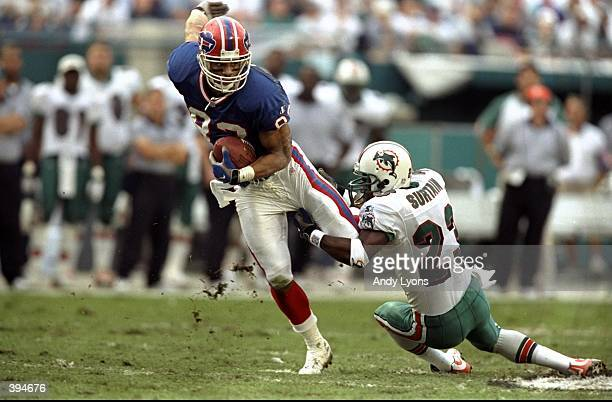 Andre Reed of the Buffalo Bills is grabbed by Patrick Surtain of the Miami Dolphins during the AFC Wild Card Gameat Pro Player Stadium in Miami...