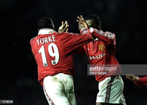 Andy Cole and Dwight Yorke of Manchester United congratulate each other after scoring a goal during the FA Carling Premiership match against West Ham...