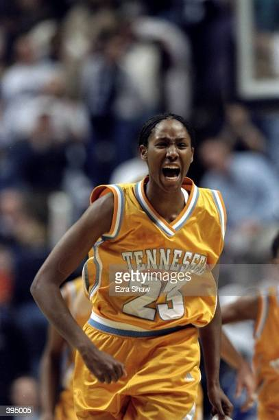 Chamique Holdsclaw of the Tennessee Lady Volunteers yelling in celebration of making the shot during the game against the UConn Huskies at the Harry...