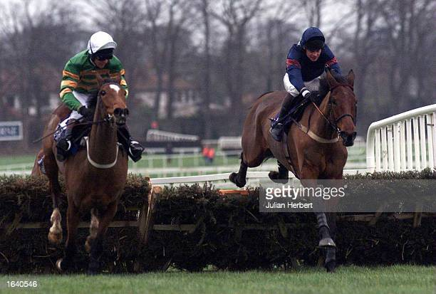 Charlie Swan and Istabraq pull away from French Holly ridden by Adrian Maguire to go on and win The Irish Champion Hurdle run at Leopardstown...