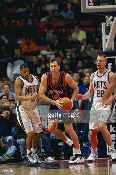 Chris Dudley of the New York Knicks dribbles the ball during a game against the New Jersey Nets at the Continental Airlines Arena in East Rutherford...