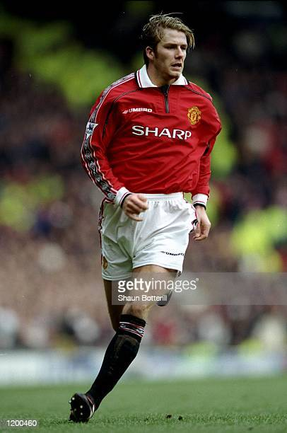 David Beckham of Manchester United in action during the FA Cup 4th Round match against Liverpool played at Old Trafford in Manchester England...