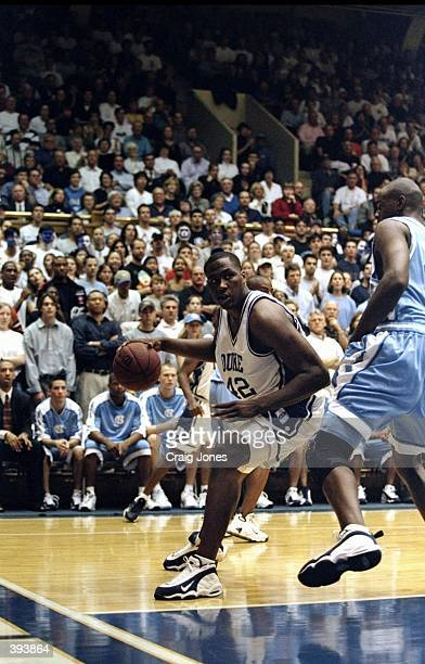 Elton Brand of the Duke Blue Devils dribbles during the game against the North Carolina Tar Heels at the Camron Indoor Stadium in Durham, North...