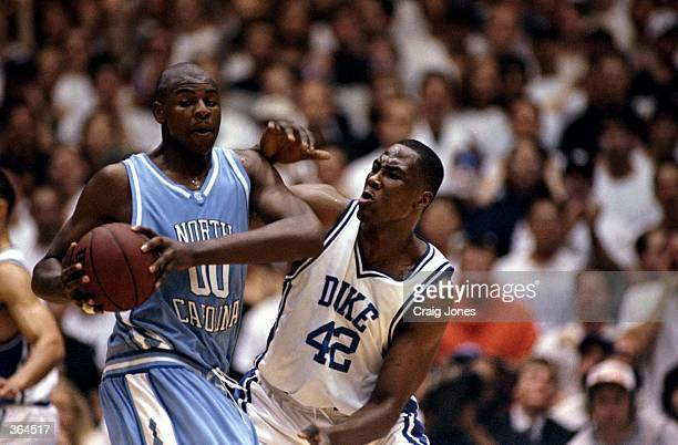 Elton Brand of the Duke Blue Devils tries to guard Brendan Haywood of the North Carolina Tar Heels at the Cameron Indoor Stadium in Durham North...