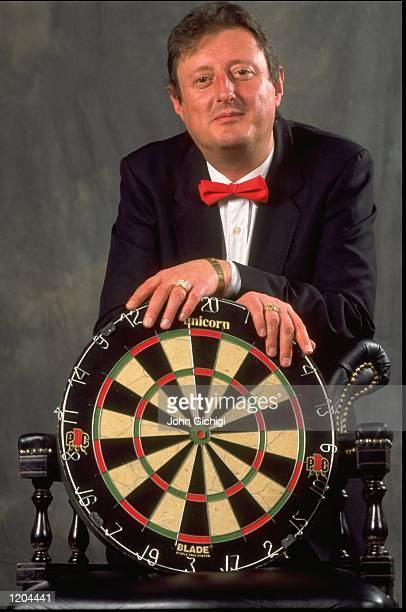 Eric Bristow of England poses with a dart board during the PDC World Darts Championships in Purfleet in Essex England Mandatory Credit John Gichigi...