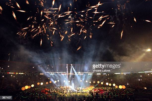 Fireworks and lightshows illuminate the field and the stadium during the halftime show for Super Bowl XXXIII between the Denver Broncos and the...