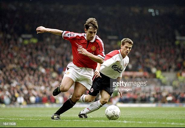 Gary Neville of Manchester United gets the better of Michael Owen of Liverpool in the FA Cup fourth round clash at Old Trafford in Manchester,...