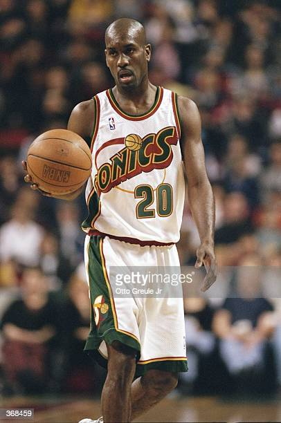 Gary Payton of the Seattle Supersonics dribbles during the game against the Vancover Grizzlies at the Key Arena in Seattle Washington The Sonics...