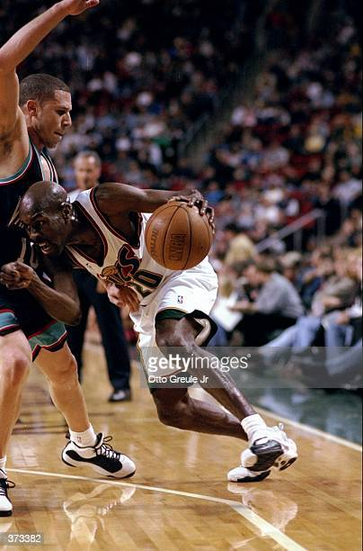 Gary Payton of the Seattle SuperSonics driving to the basket during the game against the Vancouver Grizzles at the Key Arena in Seattle Washington...