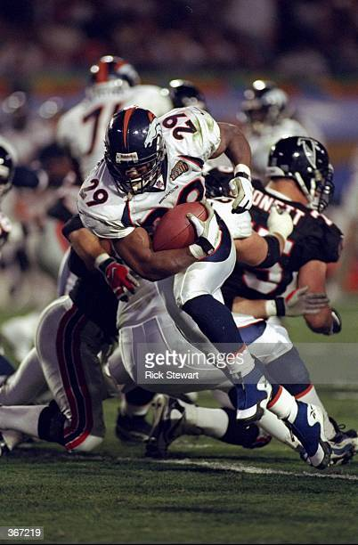Howard Griffith of the Denver Broncos carries the ball during Super Bowl XXXIII between the Atlanta Falcons and the Denver Broncos at Pro Player...