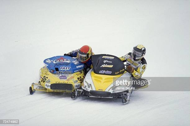 Jaques Villeneuve races Dale Loritz during the World Championship Snowmobile Derby in Eagle River Wisconsin Mandatory Credit Jamie Squire /Allsport