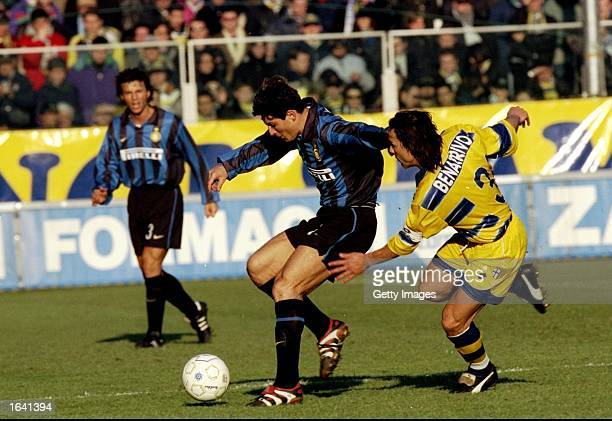 Javier Zanetti of Inter Milan is challenged by Antonio Benarrivo of Parma during the Italian Serie A match at the Stadio Tardini in Parma Italy Parma...