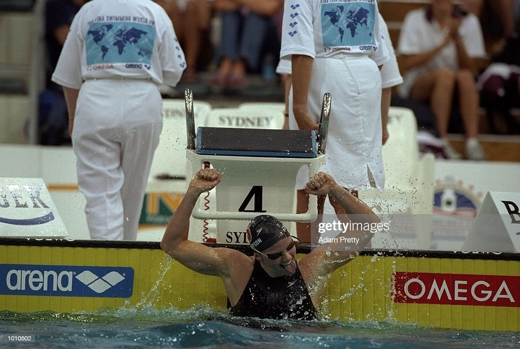 Jenny Thompson of the USA celebrates breaking the Womens 100m Medley World Record at the 1999 FINA World Cup from the Sydney International Aquatic Centre, Homebush, Sydney, Australia. \ Mandatory Credit: Adam Pretty /Allsport